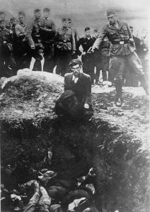 A Nazi about to shoot the last Jew left alive in Vinica, Ukraine. [Photo Credit: Library of Congress]